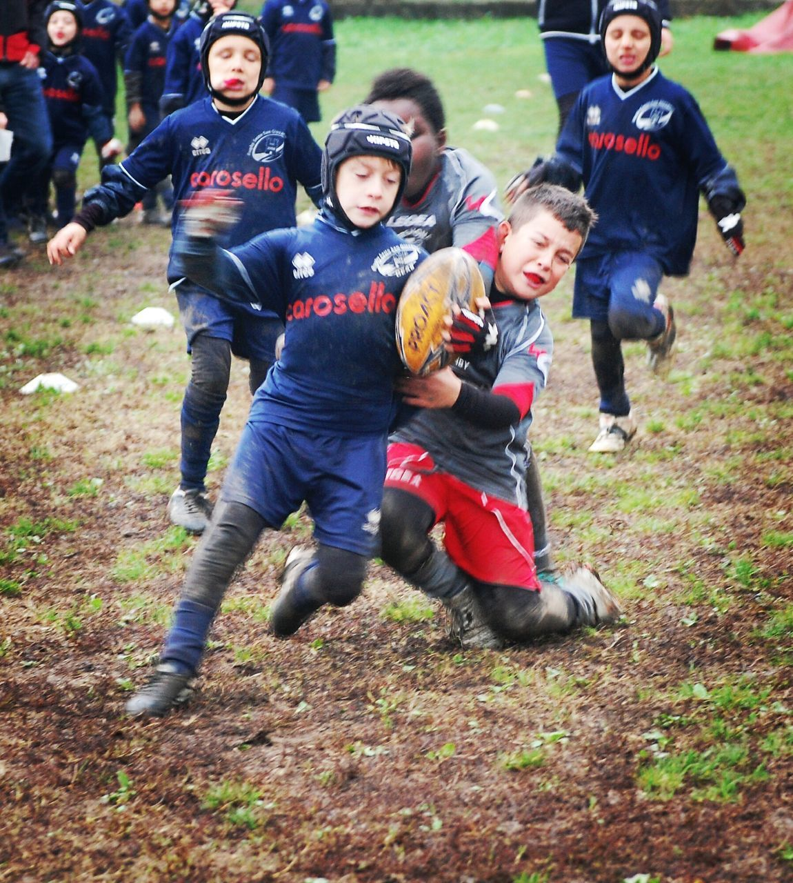 child, childhood, full length, boys, fun, children only, day, outdoors, uniform, togetherness, grass, american football - sport, people, portrait, human body part, friendship, adult