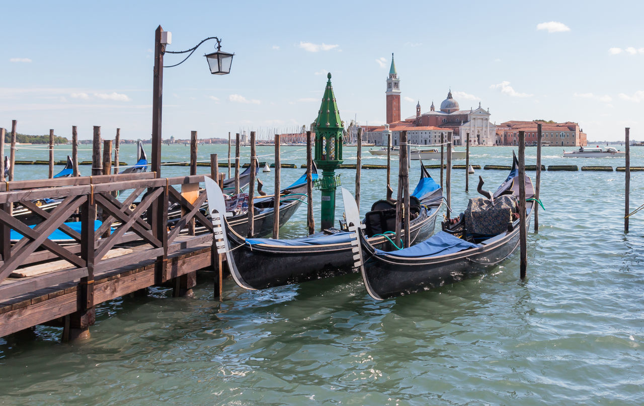 Venice, Italy - September 28, 2015 : Water channels of Venice city. Parking gondolas near St. Mark's Square on Grand Canal in Venice, Italy. Architecture Canal City Cultures Day Destination Europe Gondola - Traditional Boat Historic Holiday Italy Landmark Landscape Nautical Vessel Old Outdoors Romantic Sea Tourism Tourist Travel Travel Destinations Vacation Venice Water
