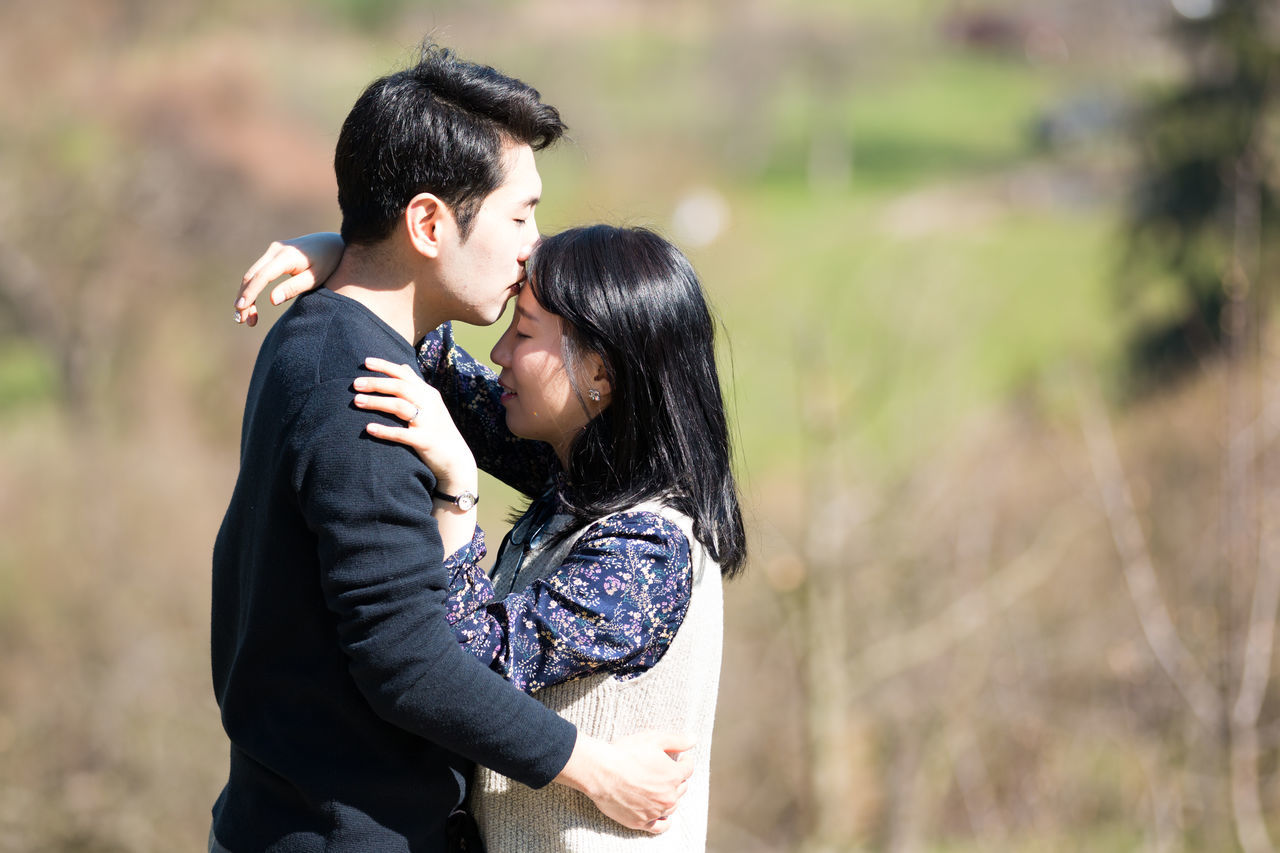 Affectionate Bonding Bride Couple - Relationship Day Embracing Focus On Foreground Friendship Happiness Heterosexual Couple Holding Love Married Men Outdoors Real People Romance Smiling Togetherness Two People Wedding Women Young Adult Young Couple Young Women