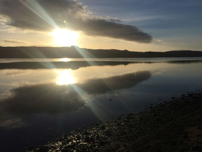 Reflection Sunlight Sunbeam Scenics Sky And Clouds River Reflections Outdoors No People Tranquility No Edit/no Filter IPhoneography Idyllic Today In Scotland Horizon Over Land Day Water Shoreline Sun Tranquil Scene Calm