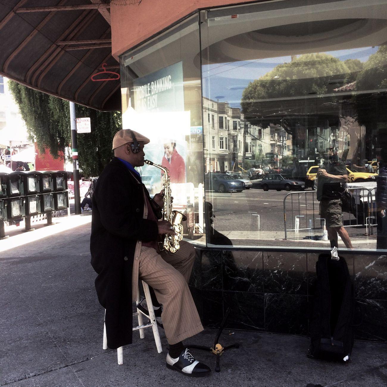 Street saxophonist at North Beach Festival.
