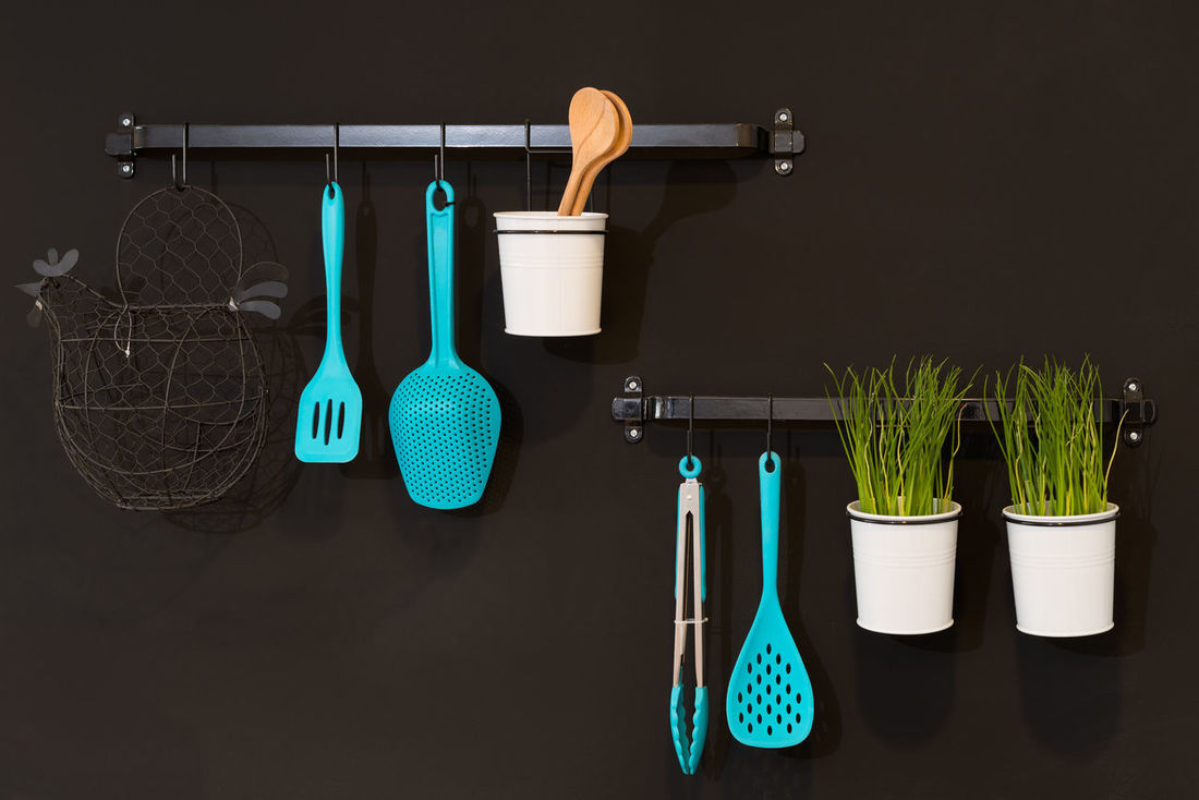 Kitchenware hanging in a black wall Household Set Spoon Wall Wood Spoon Appliances Basket Cyan Decoration Decorative Group Hanging Indoors  Interior Interior Design Kitchen Kitchen Utensils Kitchenware No People Organized Pot Skimmer Tweezers Utensil Variation