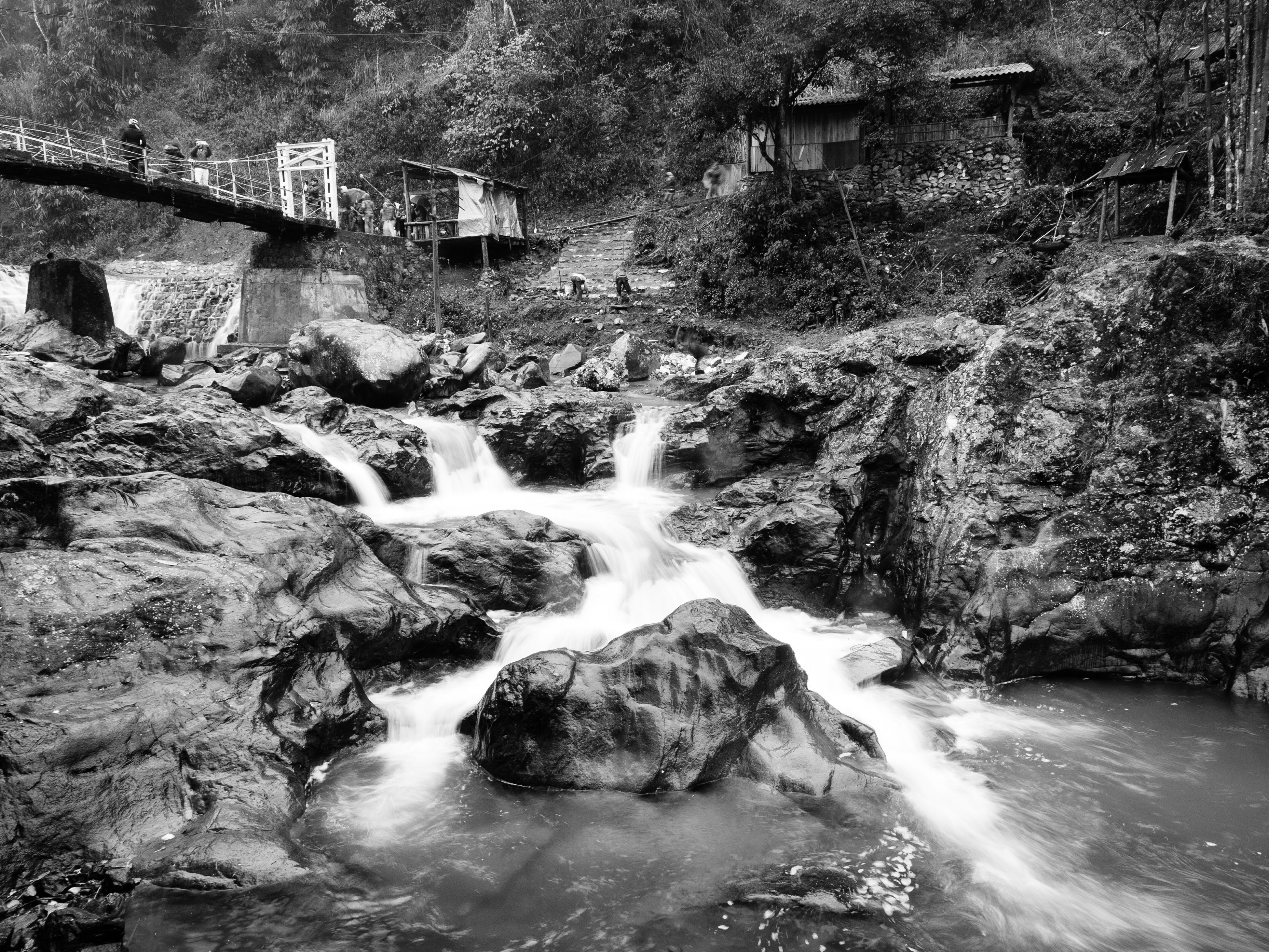 built structure, architecture, building exterior, water, flowing water, tree, motion, house, flowing, waterfall, rock - object, nature, outdoors, day, no people, stream, residential building, surf, river, residential structure