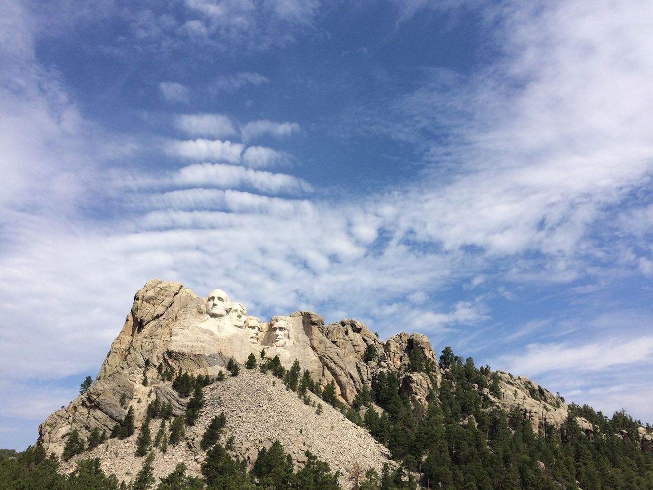 Very cooperative sky at Rushmore... Tranquil Scene Mountain Scenics Tranquility Beauty In Nature Low Angle View Tourism Sky Tree Travel Destinations Physical Geography Geology Travel Nature Remote Non-urban Scene Cloud - Sky Blue Mountain Peak The Past