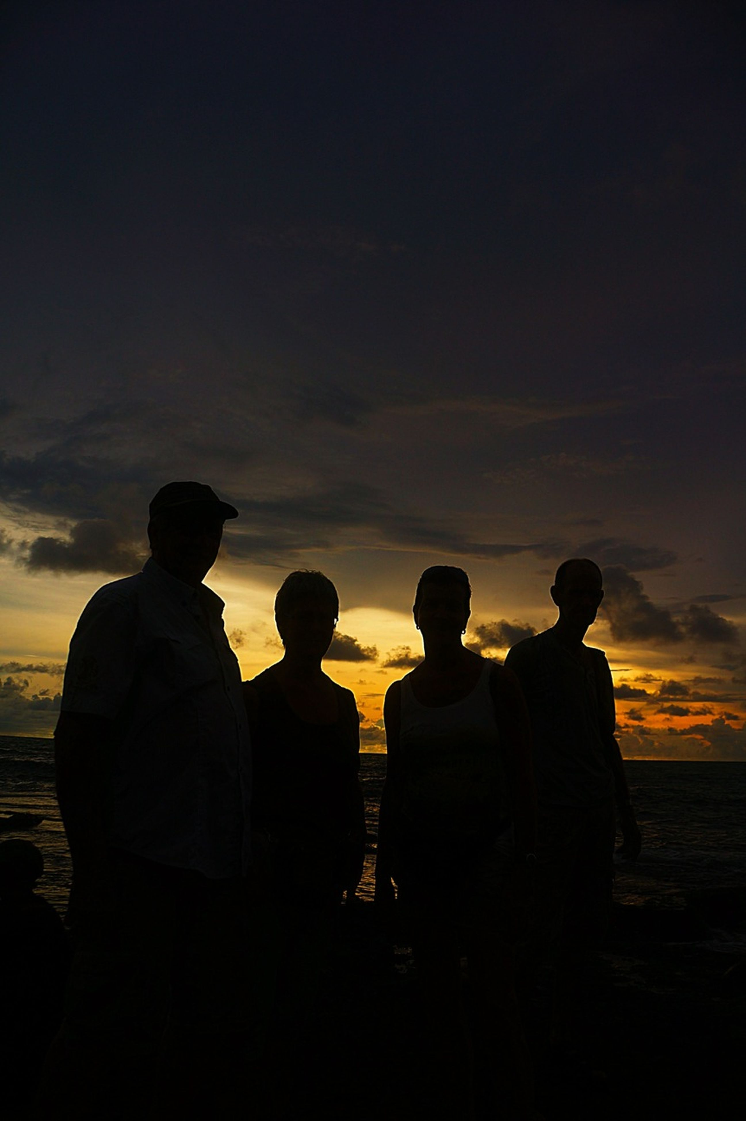 men, togetherness, silhouette, lifestyles, leisure activity, sunset, bonding, person, standing, sky, friendship, rear view, love, sitting, outdoors, medium group of people