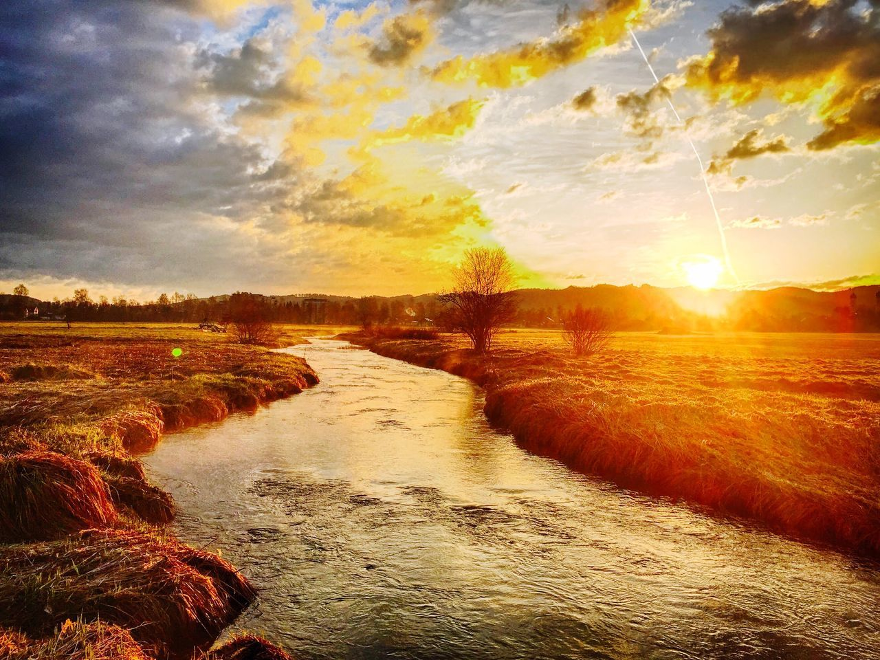 scenics, beauty in nature, nature, tranquil scene, tranquility, sky, sunset, sunlight, no people, outdoors, idyllic, water, motion, cloud - sky, landscape, river, sun, travel destinations, day, tree