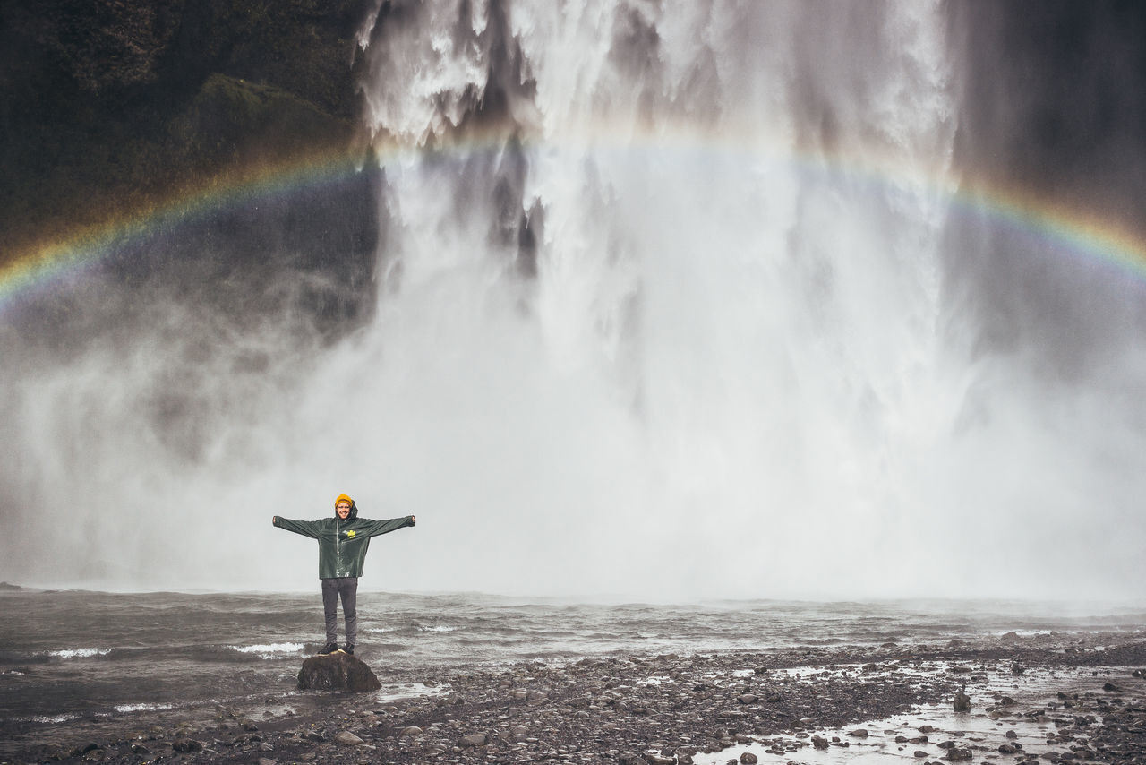Beautiful stock photos of regenbogen,  20-24 Years,  Arms Outstretched,  Awe,  Beauty In Nature