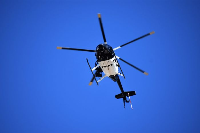 Air Vehicle Clear Sky Flying Helicopter Low Angle View Mid-air No People On The Move Police Car Police Helicopter