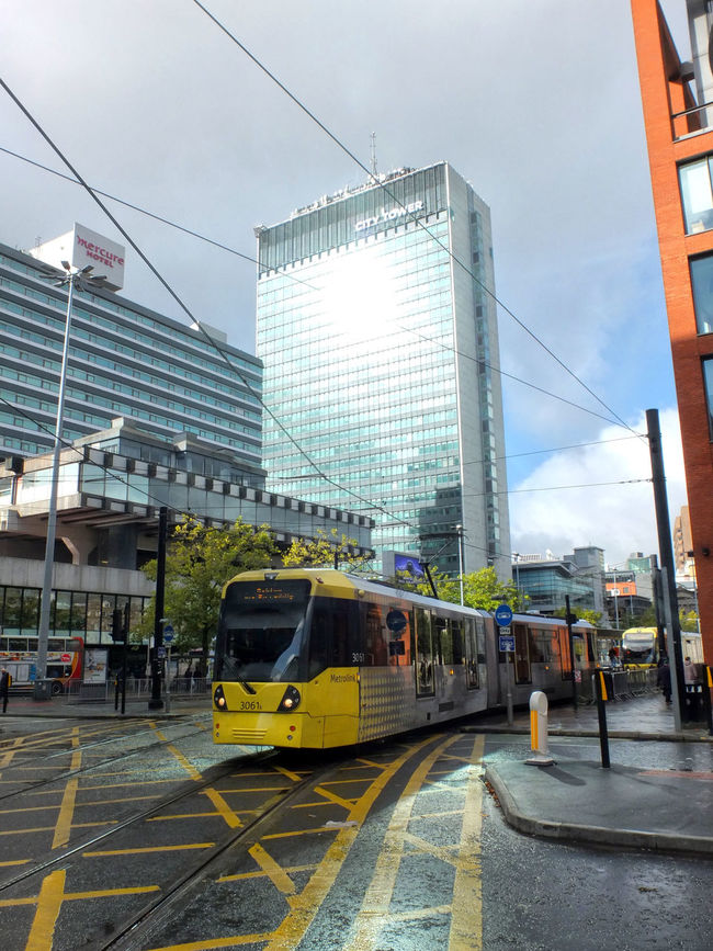 Manchester Architecture Building Exterior Built Structure Cable Car City City Street Day Land Vehicle Manchester Metrolink Mode Of Transport No People Outdoors Public Transportation Sky Skyscraper Transportation Vertical Yellow Taxi
