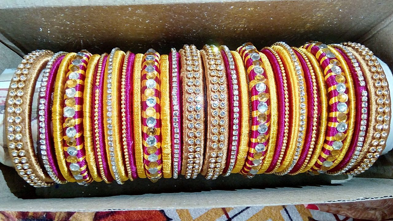 Bangles set hand made item with stones and thread cost of 1200/- Close-up Multi Colored In A Row Collection Choice Retail  Order Arrangement Arranged First Eyeem Photo