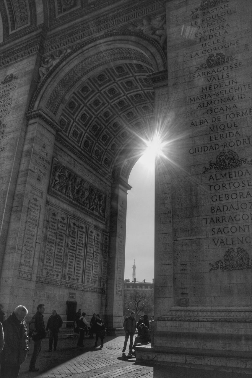 arch, architecture, built structure, real people, sun, travel destinations, illuminated, men, indoors, day, people