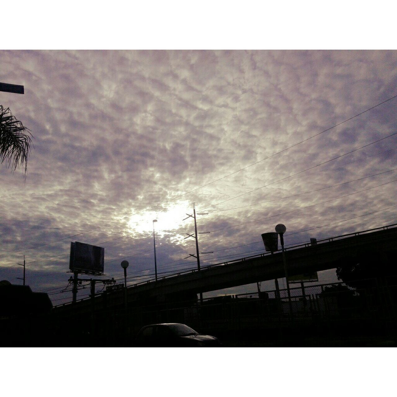 silhouette, sky, cloud - sky, transportation, low angle view, built structure, architecture, outdoors, sunset, nature, no people, day, beauty in nature
