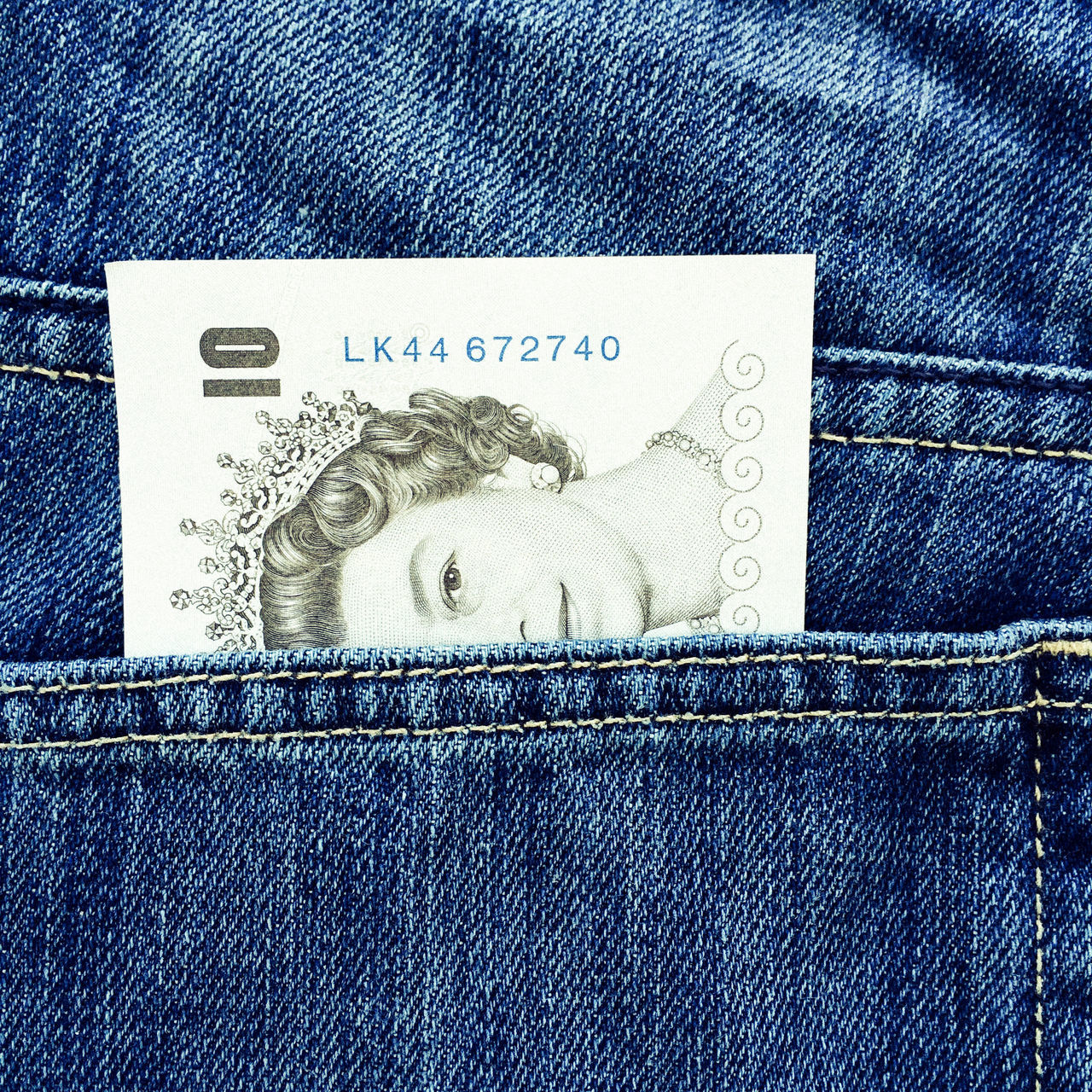 UK 10 pound note protruding from pocket of blue denim jeans 10 Pound Note 10 Pounds Bill Blue Blue Jeans British Cash Currency Denim Jeans Legal Tender Money Note Paper Pocket  Pocket Money Postprocessing Protruding Queen Queen Elizabeth  Queens Head Symbol Ten Pound Note UK£