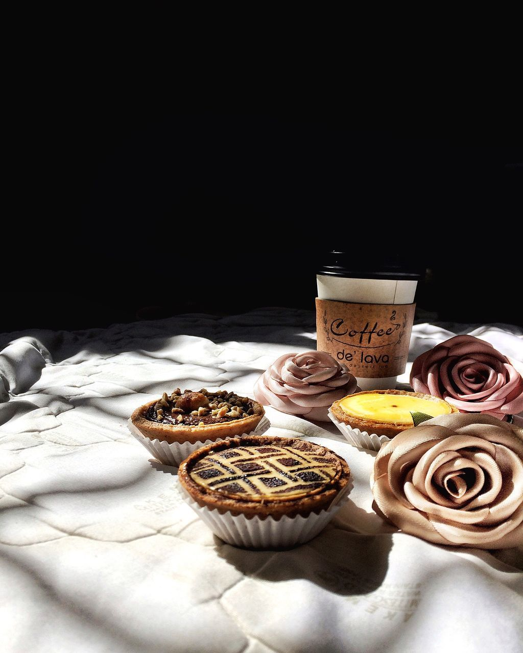 food and drink, sweet food, indulgence, cupcake, food, freshness, dessert, temptation, no people, baked, indoors, unhealthy eating, studio shot, ready-to-eat, black background, close-up, day