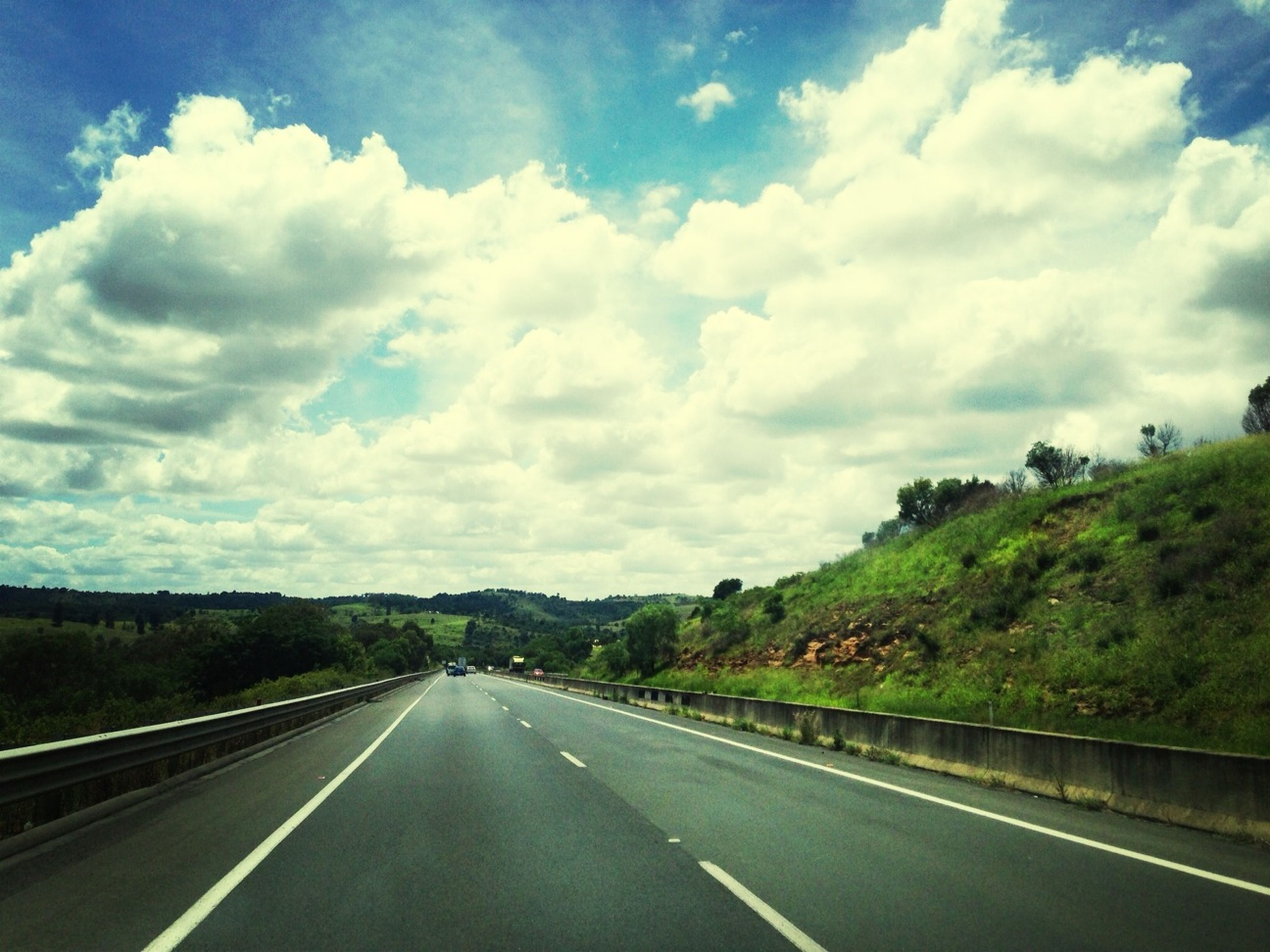 road, the way forward, transportation, road marking, sky, diminishing perspective, vanishing point, cloud - sky, country road, mountain, cloud, cloudy, empty road, highway, asphalt, landscape, empty, nature, street, day