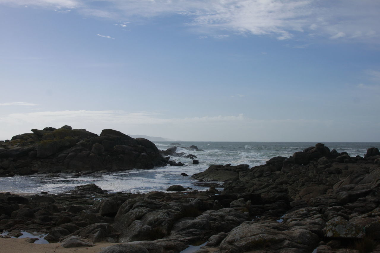 sea, nature, rock - object, rock, sky, no people, scenery, horizon over water, water, beach, beauty in nature, outdoors, scenics, day