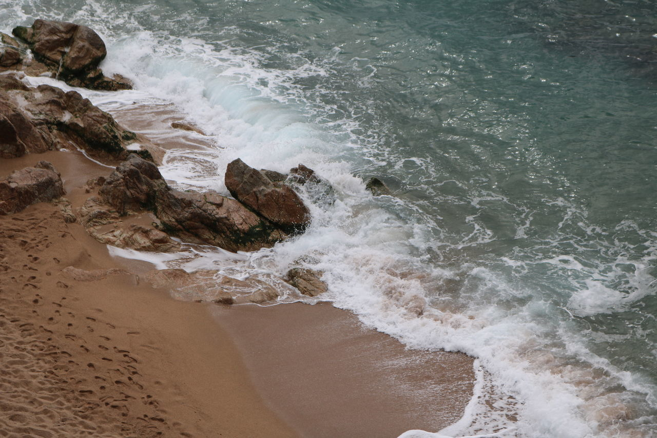 Beach Beauty In Nature Calella, Spain Day High Angle View Hitting Motion Nature No People Outdoors Power In Nature Sand Sea Splashing Surf Water Wave