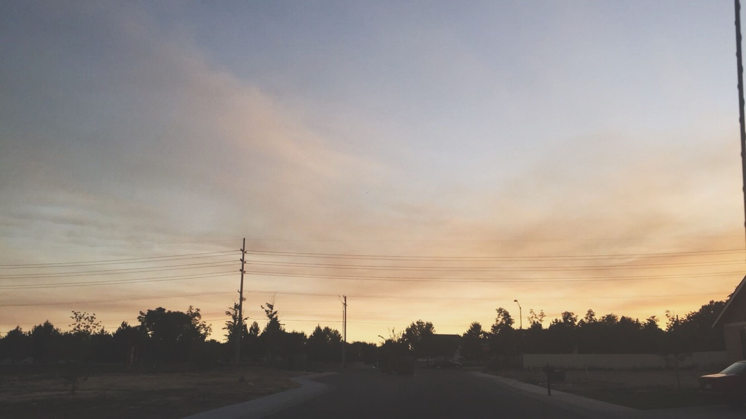 sunset, sky, power line, electricity pylon, silhouette, tree, tranquil scene, tranquility, road, landscape, electricity, scenics, orange color, cloud - sky, the way forward, nature, beauty in nature, connection, cloud, power supply