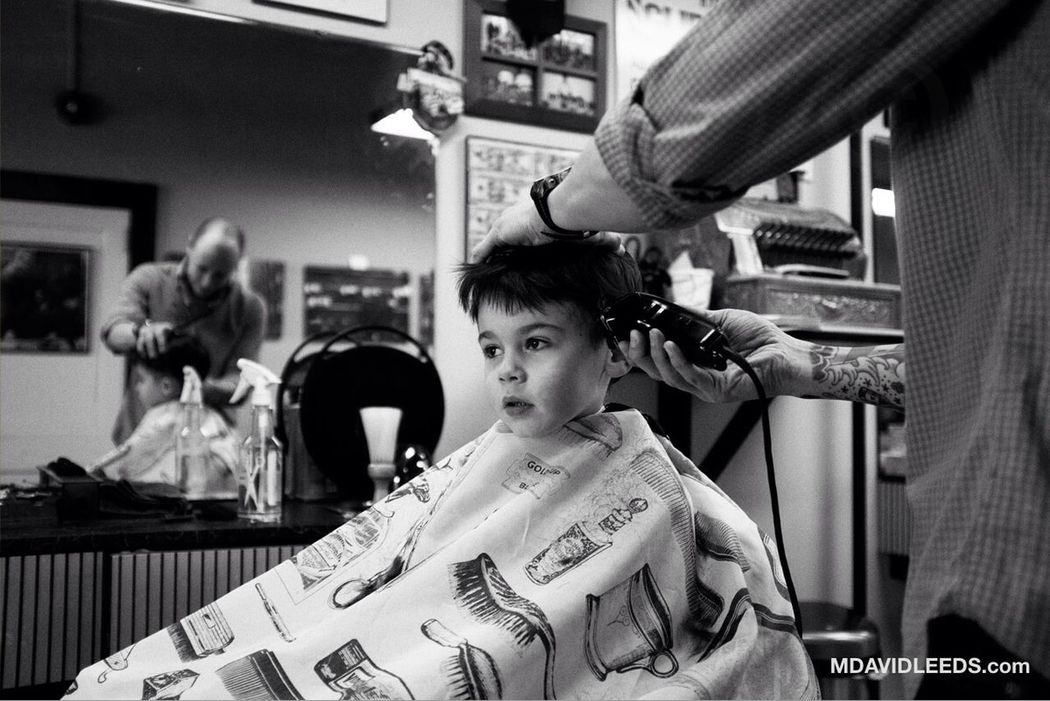 "Freddie, getting a fresh cut ""just the way he likes it!"" at Ryan's Clip Joint, in Morris Plains, NJ. Fuji X100s Barbershop Blackandwhite Mdavidleeds Photos"