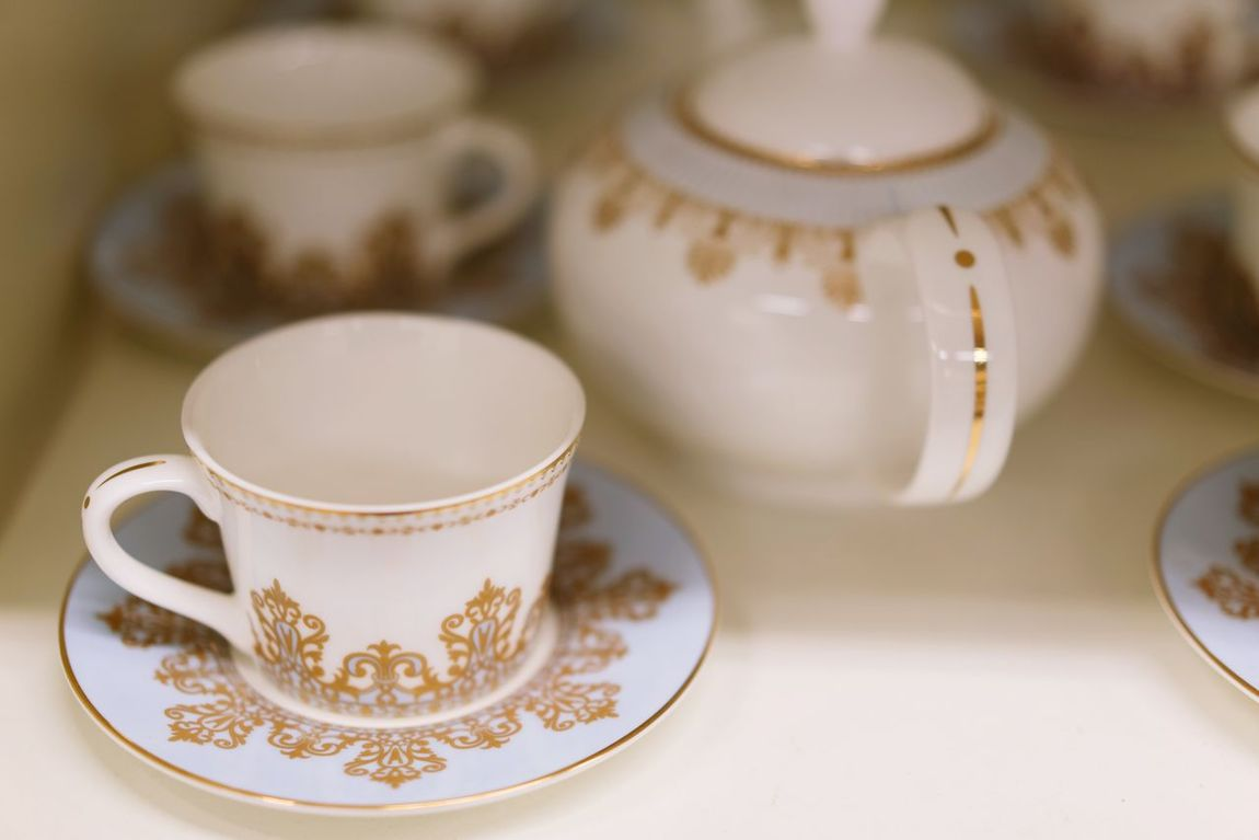 Porcelain  Tea Cup Tea - Hot Drink Indoors  No People Food And Drink Afternoon Tea Japanese Tea Cup Plates Tea Set Dishes Dishes Set Shelves Shopping Retail  For SaleArrangement Shelf White Gold Golden White Color Plate Store