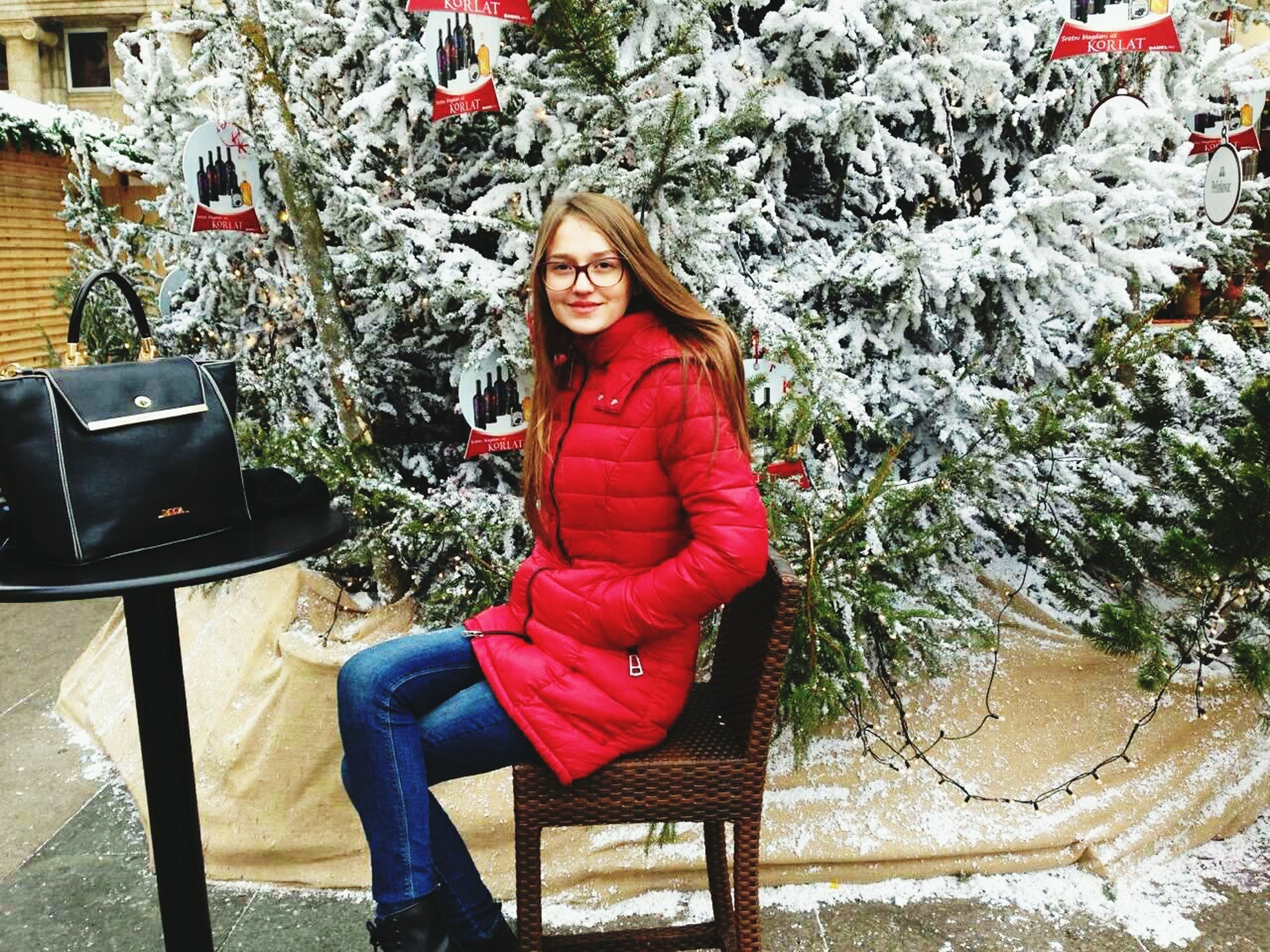 full length, red, looking at camera, young women, portrait, young adult, tree, sitting, beautiful woman, one person, one woman only, one young woman only, real people, only women, winter, outdoors, day, people, adults only, adult
