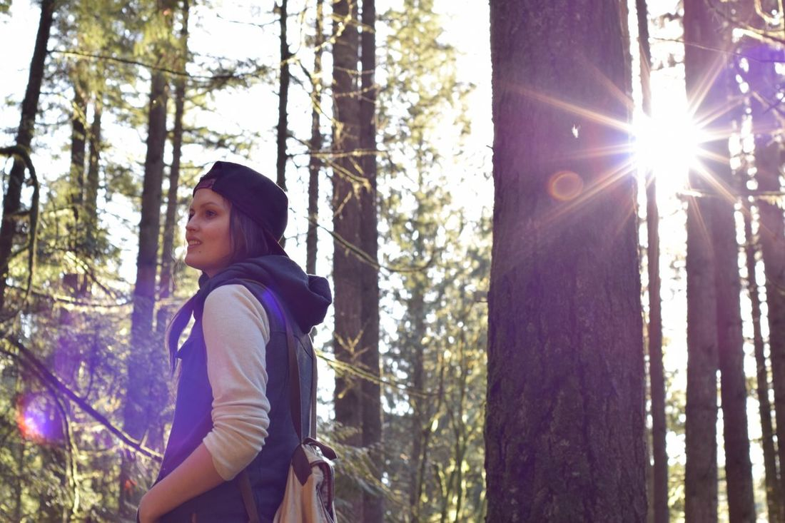 Forever getting lost somewhere in the forests of BC Lens Flare Sunlight One Woman Only Only Women One Person WoodLand Looking Up Standing Low Angle View Tree Women Forest People Day Adults Only Real People One Young Woman Only Outdoors Sunbeam Adult Nikon Hikebc Hike Forest Photography