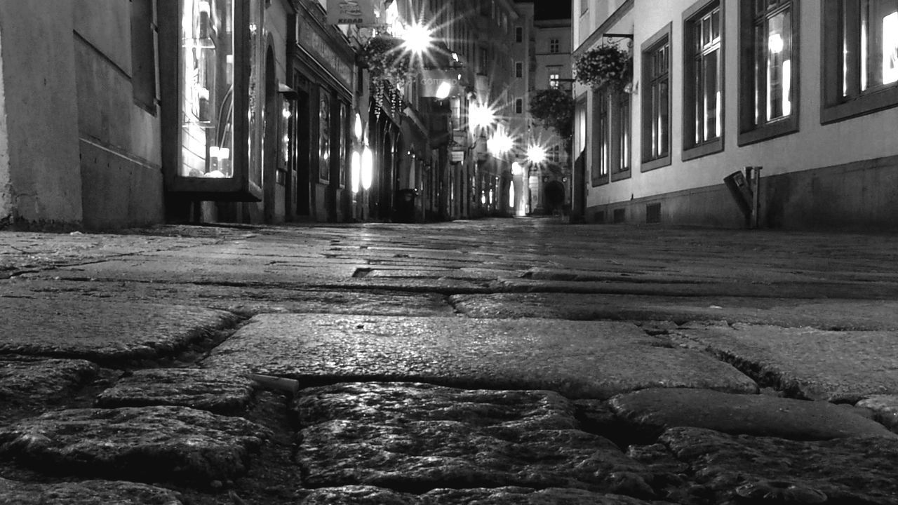 Cobblestone street at night in historic city Historic Street Cobblestone Cobblestone Streets Cobblestones Cobbled Street Road Monochrome Monochromatic Black & White Room For Text No People Graphic Design Bradleywarren Photography Bradley Olson Black And White Open Space Diminishing Perspective Old Urban City Moving Forward  Street Light Illuminated Vanishing Point