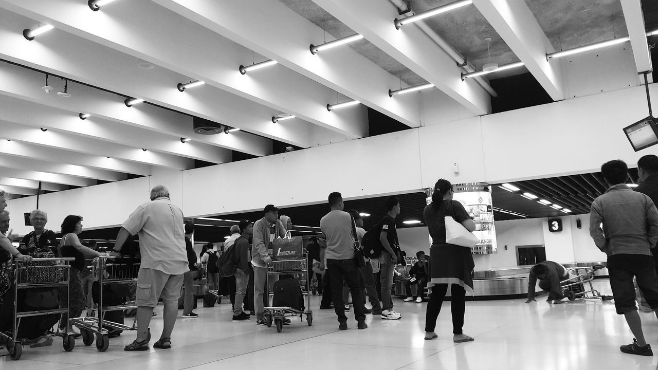 The Photojournalist - 2016 EyeEm Awards Waiting Luggage Airport Waiting Fall Down Accident Looking Blackandwhite Black And White Blackandwhite Photography Black And White Photography Blackandwhitephotography Not Arriving People People Waiting People Photography My Trip The Architect - 2016 EyeEm Awards