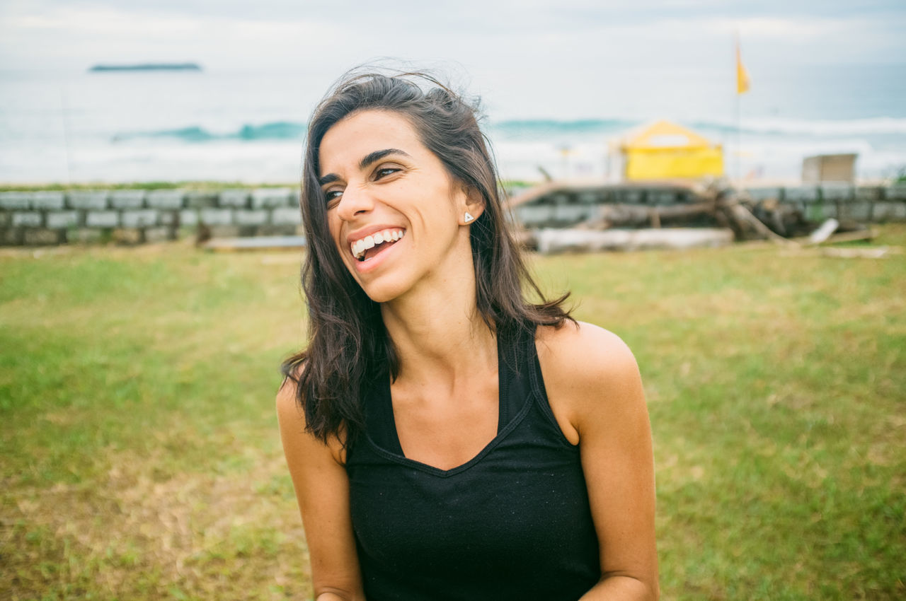 Beach Beautiful Woman Brazil Day Florianópolis Focus On Foreground Happiness Leisure Activity Lifestyles Looking At Camera One Person Outdoors People Portrait Real People Sky Smiling Young Adult Young Woman Young Women