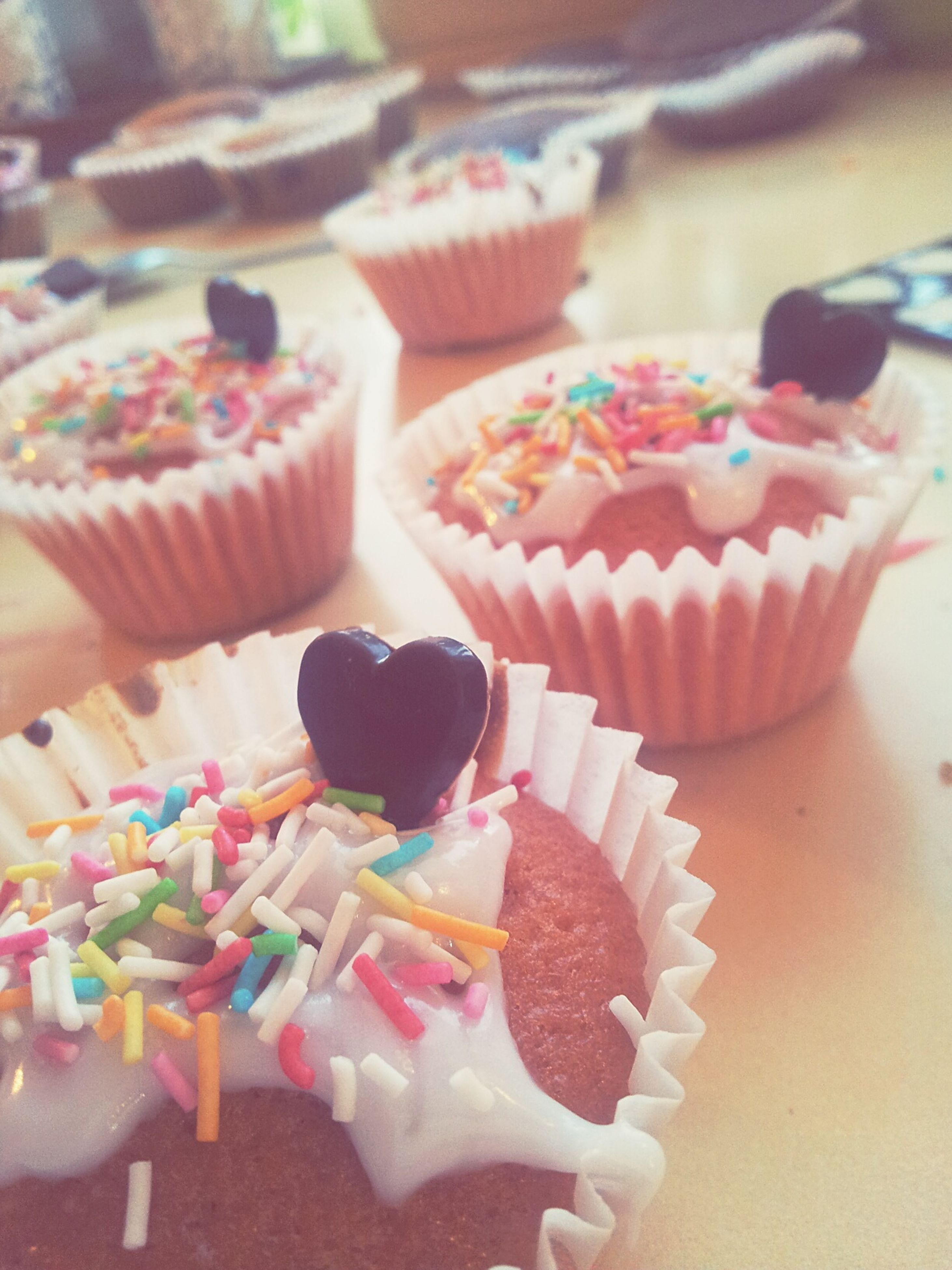 food and drink, sweet food, food, indoors, dessert, freshness, ready-to-eat, indulgence, unhealthy eating, still life, cake, temptation, table, plate, close-up, chocolate, serving size, cupcake, pastry, icing