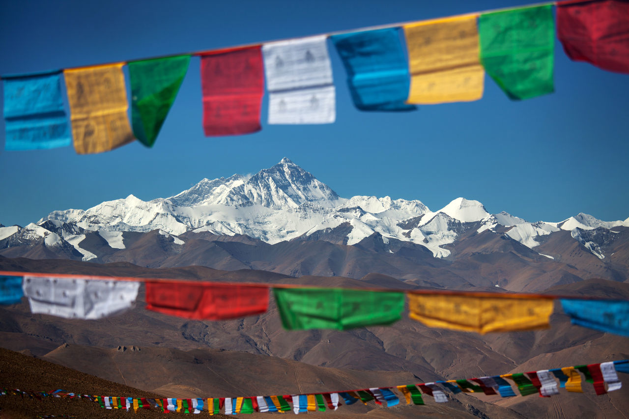 Mount Everest stand out among the Himalayan range, with colourful Tibetan prayer flags as foreground. Beauty In Nature Bunting Cold Temperature Day Everest Everest Base Camp Flag Himalayas Landscape Mountain Mountain Range Moutain Multi Colored Nature No People Prayer Prayer Flags  Sky Snow Snowcapped Mountain Tibet Tibetan Buddhism Travel Winter