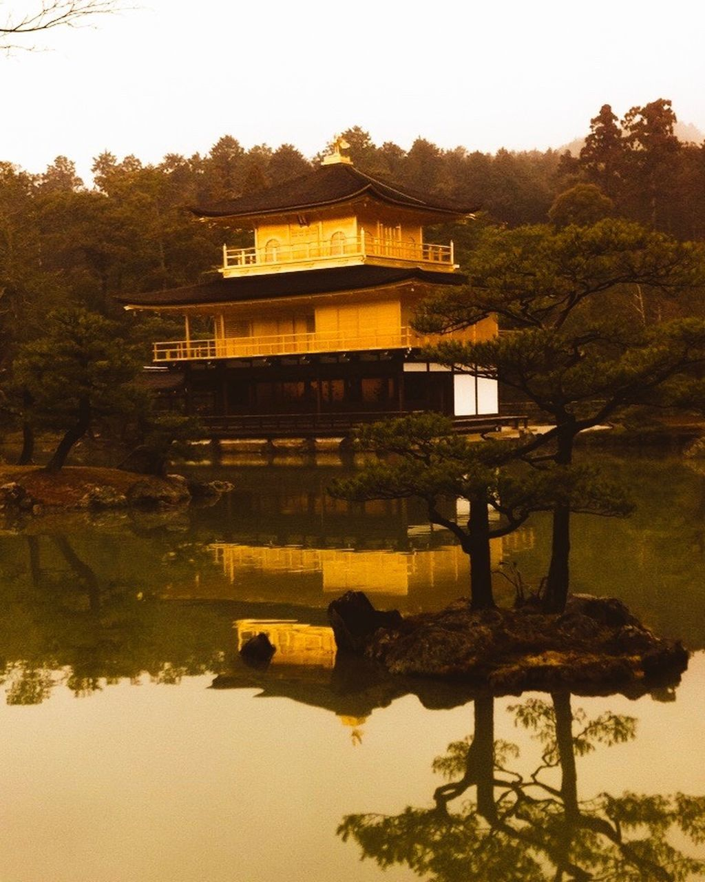 architecture, built structure, tree, building exterior, reflection, water, travel destinations, outdoors, no people, nature, scenics, tranquility, lake, sunset, day, beauty in nature, sky