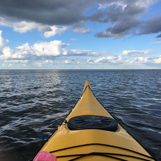 Kayaking Sky Cloud - Sky Water Yellow Sea Nature No People Day Outdoors Scenics Beauty In Nature Tranquility Horizon Over Water Nautical Vessel Close-up
