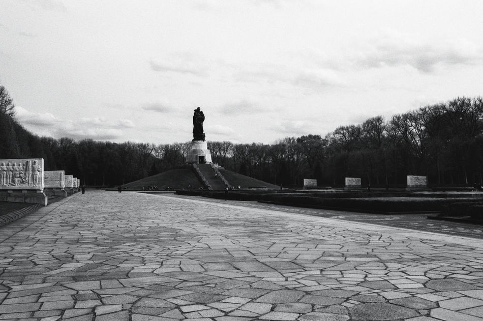 Remember. Architecture Berlin Building Exterior Built Structure Cobblestone Day Human Representation Nature One Person Outdoors People Russian War Memorial Sculpture Second World War Memorial Sky Statue Tree