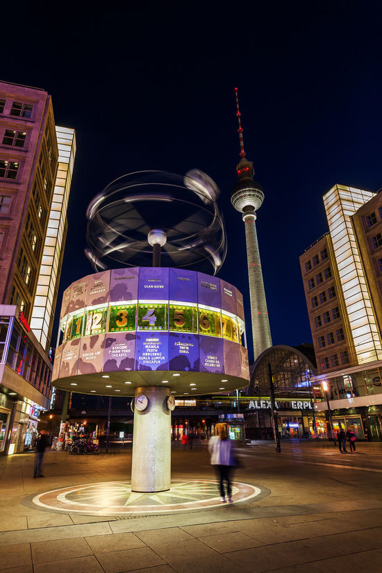 world time clock on Alexanderplatz, Berlin, Germany, at night Alexanderplatz Architecture Berlin Building Exterior Built Structure City Clock Darkness Darkness And Light Europe Germany Illuminated Night Sky Square Television Tower Tourist Attraction  Tower Travel Destination Travel Destinations Urania World Time Clock