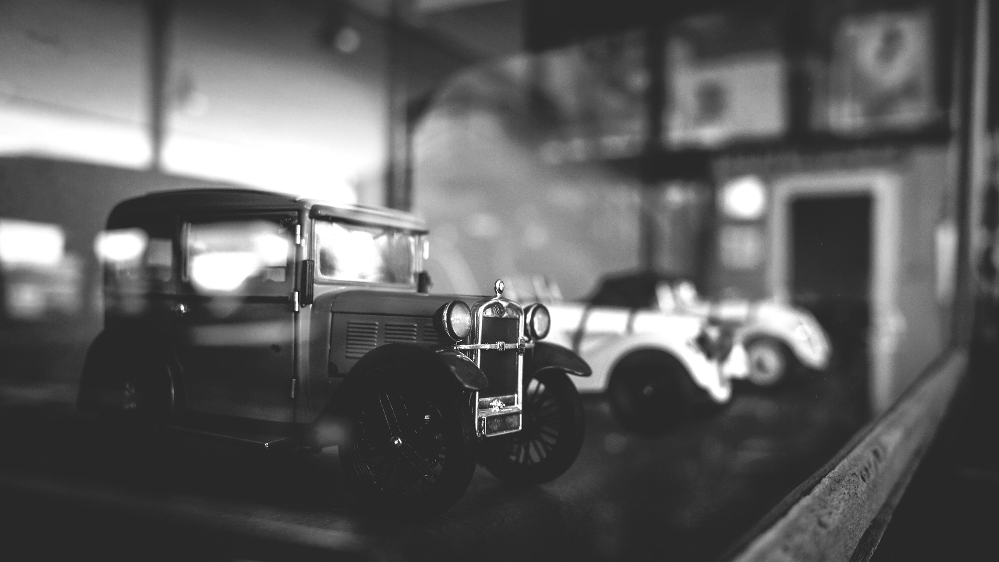 transportation, land vehicle, mode of transport, focus on foreground, window, car, glass - material, indoors, transparent, close-up, building exterior, built structure, architecture, reflection, selective focus, no people, illuminated, stationary, technology, day