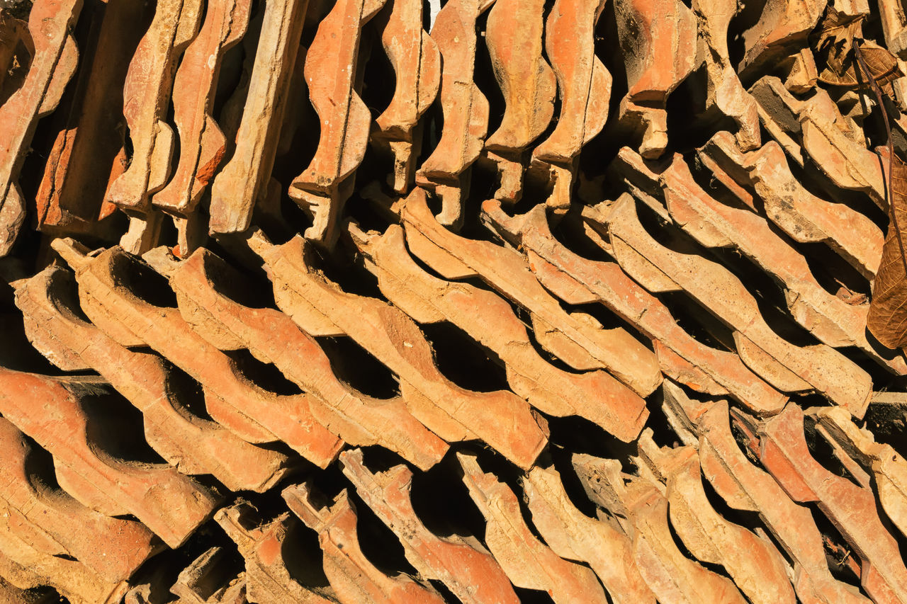 Roof Tiles Backgrounds Baked Clay Close-up Construction Materials Construction Site Day Full Frame Glazed Pottery Nature No People Outdoors Overlapping Rectangles Roof Tiles Stacked Stacked Tiles Terracotta Tile