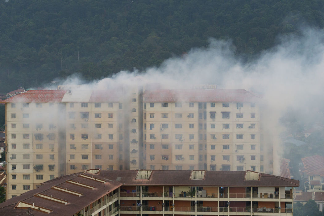 Mosquito fogging is the best practice in Malaysia in order to control mosquitoes that may carry dengue or zika virus. Aedes Architecture Building Exterior Built Structure City Day Dengue Fever Mosquito Epidemic Fogging Mosquito No People Outdoors Residential Building Smoke - Physical Structure Zika Virus