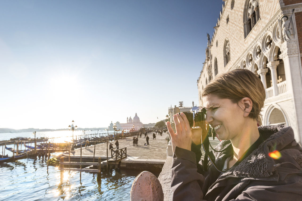 Venice, tourist taking pictures at the palazzo ducale Attraction Camera Canale Grande City Ducale Female Girl Italy Micro Four Thirds Modern Photo Recreation  Sightseeing Single Sunset System Camera Tourism Tourist Travel Travel Destinations Trip Venedig Venice Winter Women
