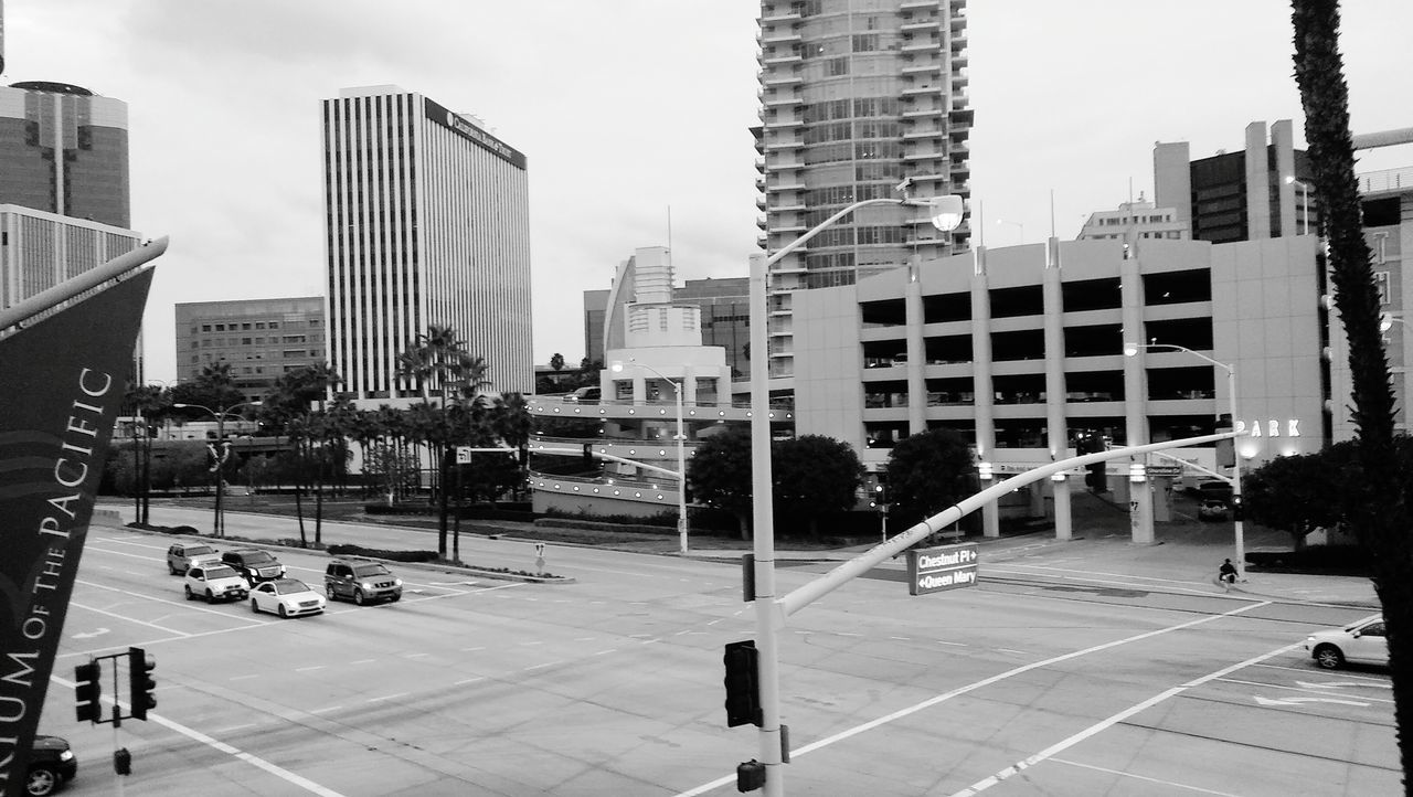 architecture, building exterior, city, built structure, skyscraper, street, car, outdoors, road, day, modern, no people, sky, cityscape