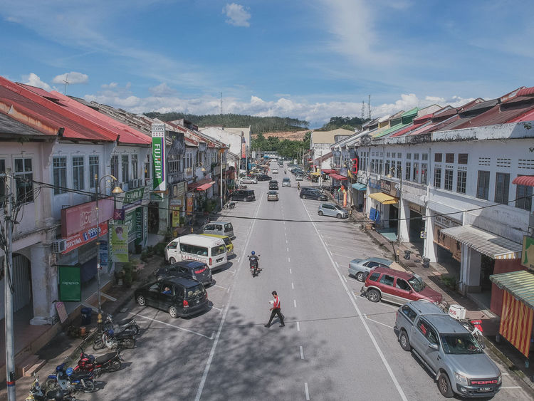 Old vintage shop lot at Slim River, Perak Malaysia. Architecture Building Exterior Built Structure Car City Day High Angle View Land Vehicle Large Group Of People Men Mode Of Transport Outdoors People Real People Road Sky Street Transportation