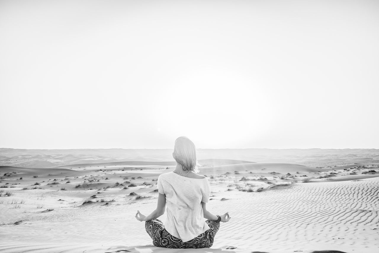 Beauty In Nature Calm Desert Desert Landscape Meditate Meditation Oman One Woman Only Peace Rear View Relax Sand Sand Dune Sitting Solitude Tranquility Wahiba Sands