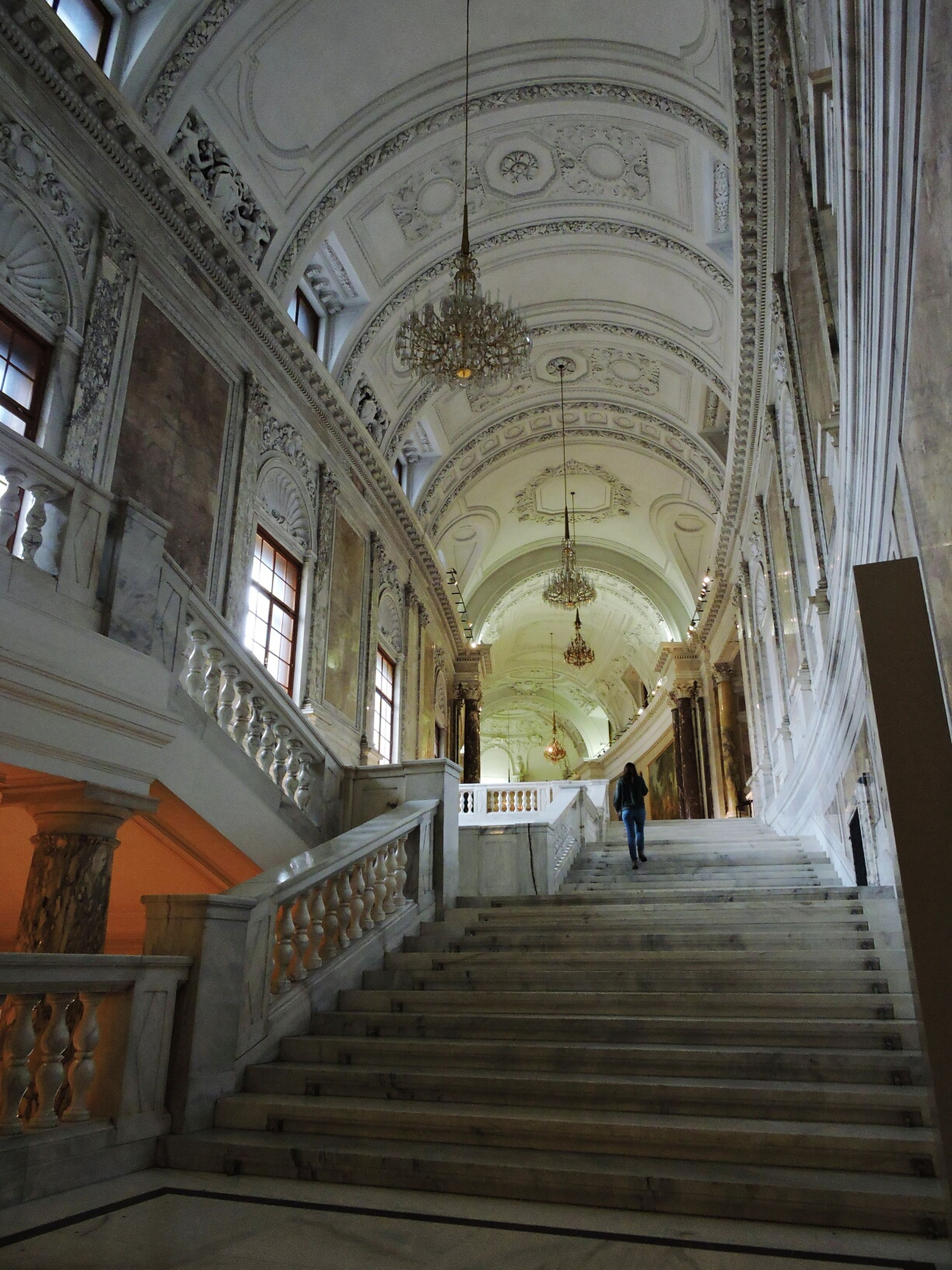 indoors, architecture, ceiling, built structure, arch, lifestyles, men, person, leisure activity, full length, steps, corridor, walking, place of worship, rear view, travel, architectural column, the way forward