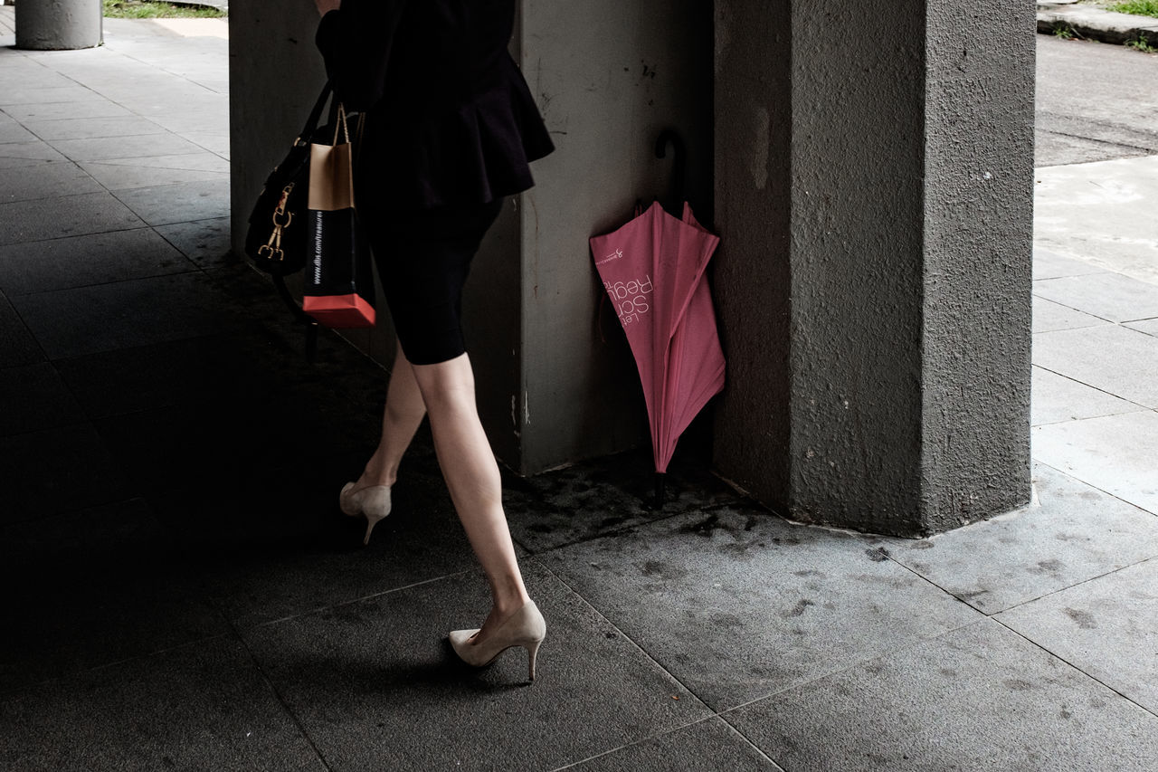 Left behind. One Woman Only Human Body Part Human Leg Low Section Pink Umbrella Legs Walking Street Photography Streetphotography Streetphoto_color Streetlife Street Life Everybodystreet FUJIFILM X100S