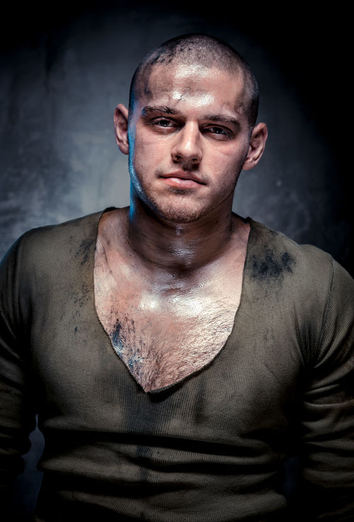 Portrait of muscular young man with dirty face and chest Athlete Athletic Caucasian Gray Background Guy Handsome Man Muscle Muscular Muscular Build Muscular Man One Person Person Physique  Shaven Head Sport Sportive Strength Strong Young Adult