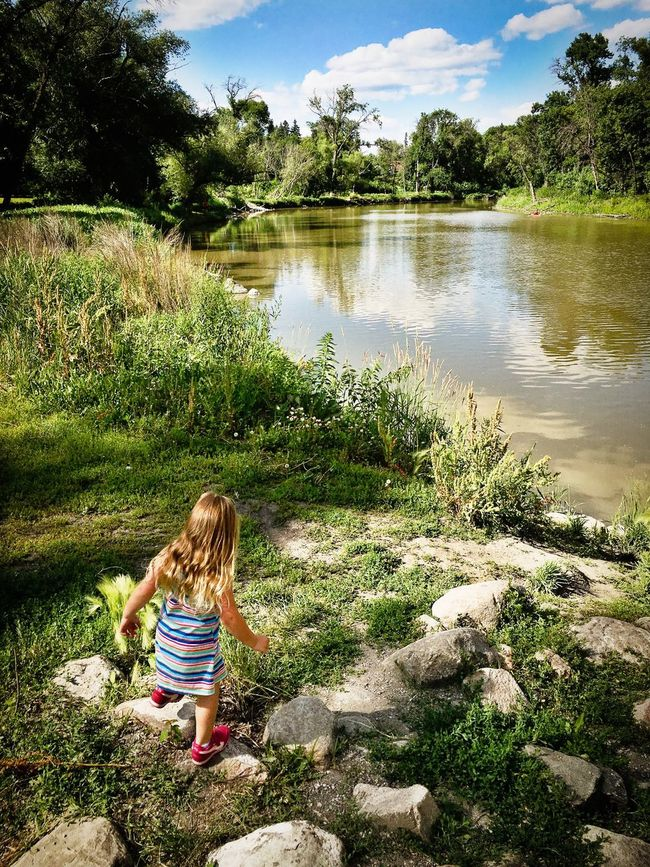 Child River Play Riverside Girl Playing North Dakota Fargo IPhoneography Summer Red River Wildflowers Rocks Rocks And Water Picoftheday Afterlightapp