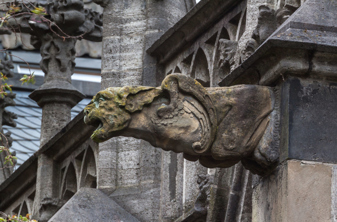 statue, gargoyle, sculpture, art and craft, architecture, built structure, animal representation, building exterior, day, outdoors, carving - craft product, history, no people, lion - feline, low angle view, close-up