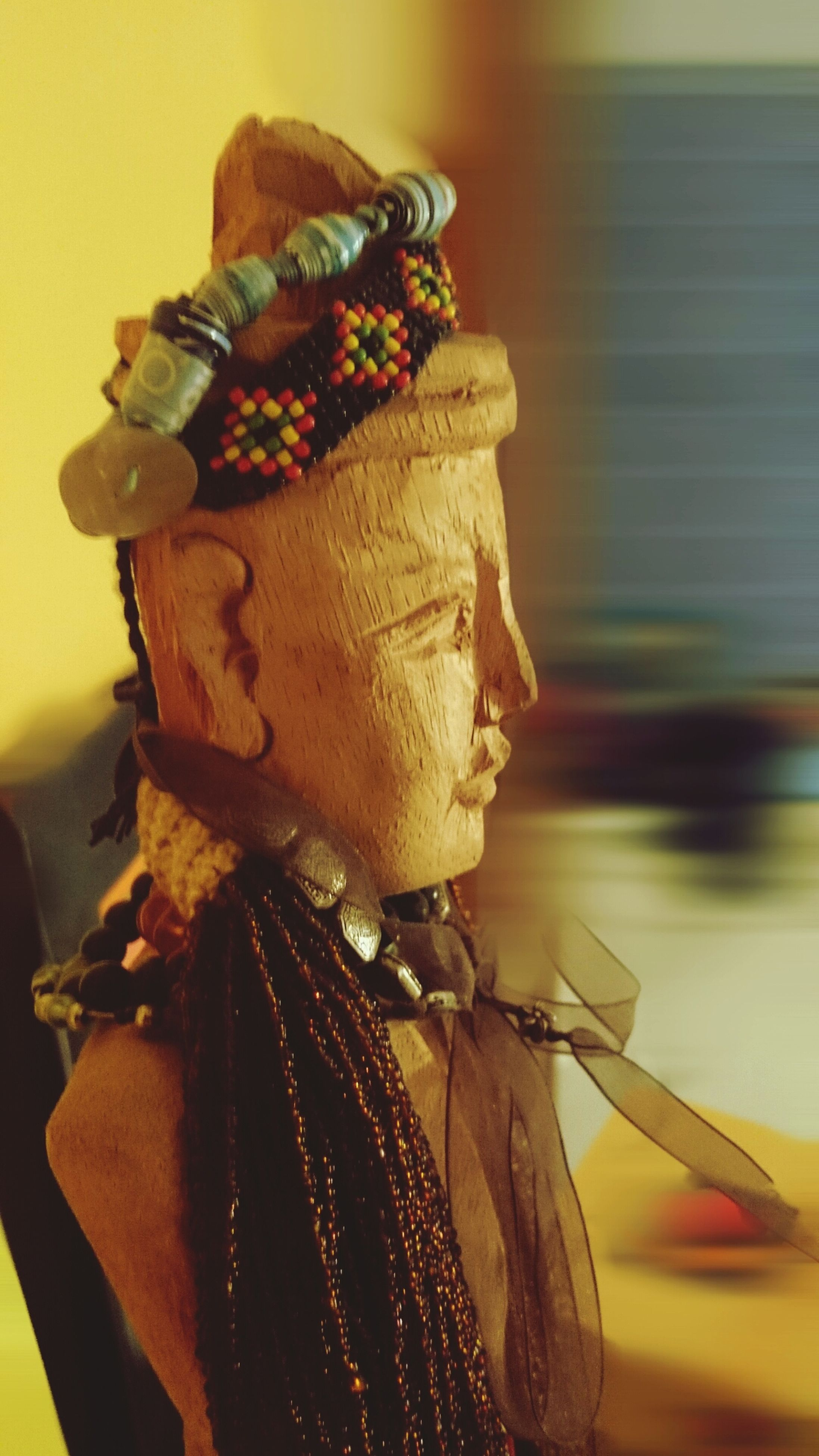 close-up, focus on foreground, art and craft, art, creativity, animal representation, human representation, indoors, sculpture, statue, yellow, no people, day, selective focus, figurine, brown, craft