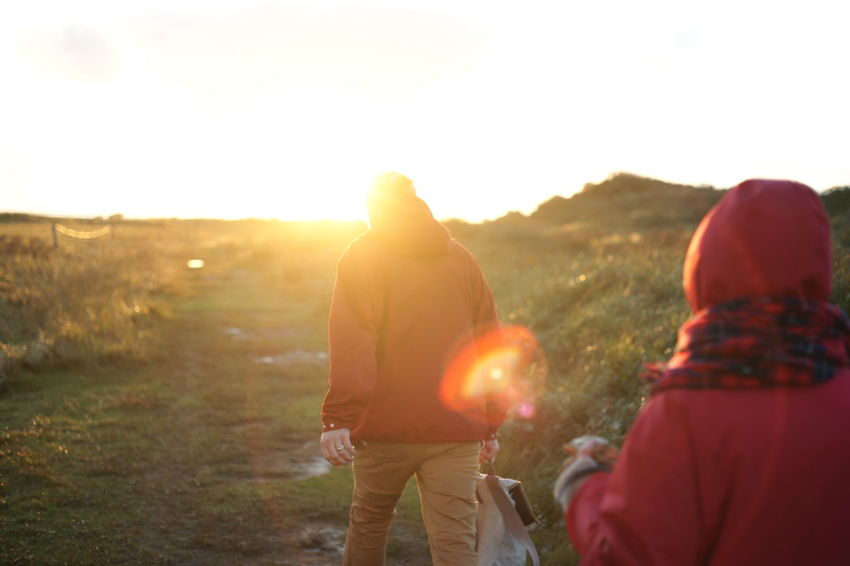 Adult Adventure Backpack Clear Sky Field Friendship Georgian Photographer Grass Hiking Landscape Lashafox Leisure Activity Men Mountain Nature Outdoors People Real People Rear View Sky Standing Sunlight Sunset Togetherness Two People Second Acts