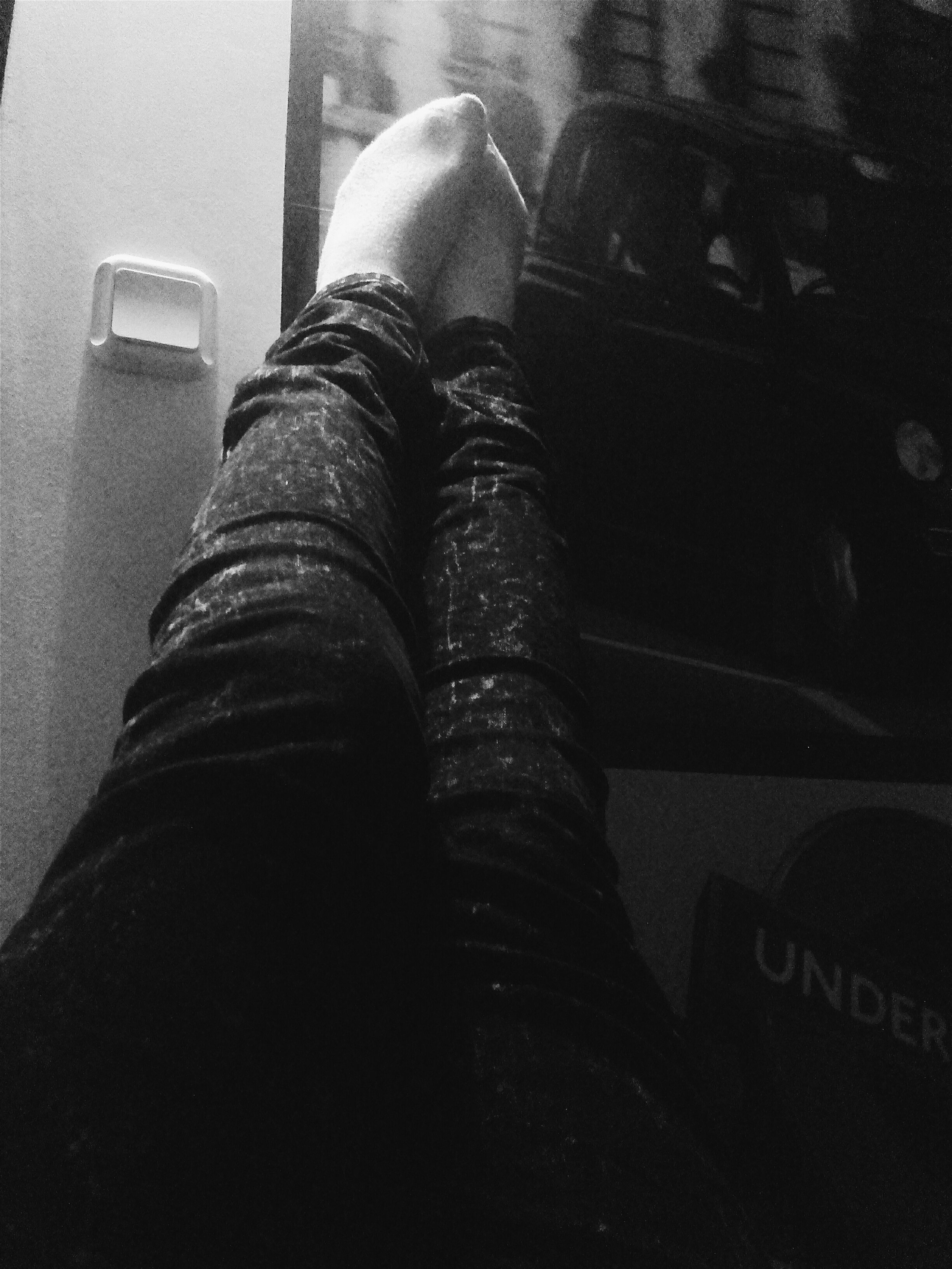 low section, personal perspective, person, indoors, lifestyles, men, part of, shoe, communication, close-up, leisure activity, unrecognizable person, text, jeans, high angle view, human foot